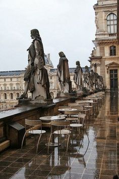 Musée du Louvre in Paris, France show this view of the elegant statues of people looking out upon the city from the restaurant patio deck. Notice the lovely reflections of the statues and building, reflecting off the wet rain-soaked floor. Oh The Places You'll Go, Places To Travel, Places To Visit, Paris Travel, France Travel, Jardin Des Tuileries, Louvre Paris, Belle Photo, Dream Vacations