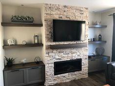 step down family room design Basement Fireplace, Home Fireplace, Fireplace Remodel, Living Room With Fireplace, Fireplace Design, Fireplace Ideas, Fireplaces, Stone Wall Living Room, Basement Ceilings