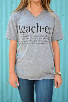 Our Teacher Webster T-shirt by August Bleu is printed on a soft, grey, tri-blend v-neck in black ink. The shirt says... teach•er noun • The profession that creates all other professions. The only job