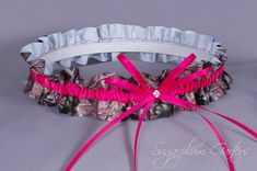 Custom Wedding Garter in Hot Pink and Realtree Camo Grosgrain with Swarovski Crystal $21.99  #realtreecamo #camowedding
