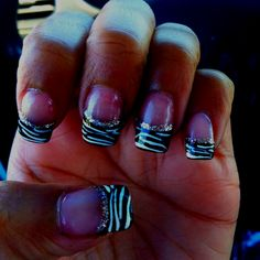 Zebra Print Nails! Thinking about getting these next time I get by nails done. :)