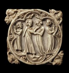 Cover of a Case for a Mirror  France, Circa 1340  Name: Cover of a Case for a Mirror Place of creation: France Date: Circa 1340 Material: ivory Technique: carved Dimension: 6,8x6,9 cm