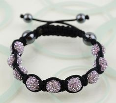 Crystal Disco Clay Ball Friendship Style Bracelets --  Light Purple. $6.99, via Etsy.