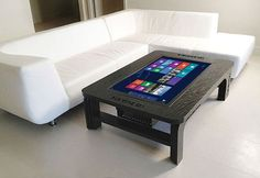 "One of the coolest items I've seen lately is definitely the Hammacher Schlemmer's coffee table which incorporates a functional 32 inch Windows 8 computer. Once placed in the living room, this intriguing tech-table ""unleashes"" its true potential. Yes, it completes the décor of any room but it has, obviously, a geekier function. You can play …"