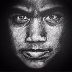 Upside-down drawn portrait, white charcoal on black paper