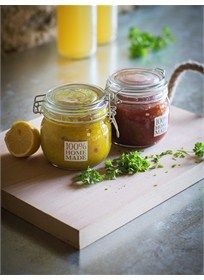 A stylish clear glass storage jar with lid is ideal for home preserving.