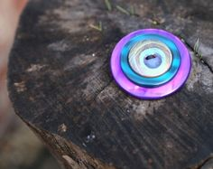 Layered button brooch, peacock feather button