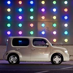Nissan Cube by Nissan. I have loved this car for months. It reminds me of Postman Pat's car.