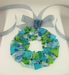 """A simple yet awesome glass craft that utilizes """"green"""" materials to make an easy to do wreath that can be used as an ornament or sun-catcher...."""