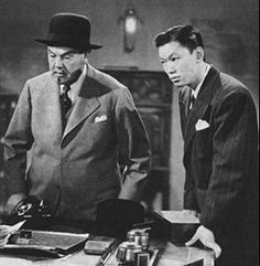 Charlie Chan (Sidney Toler) with son Tommy