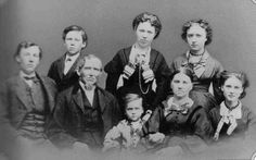 Almanzo Wilder's family, undated photo:  front back row: Almanzo, Laura, Eliza Jane; front row: Royal, James, Perley, Angeline, Alice.