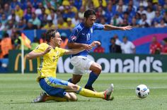 Albin Ekdal of Sweden slides to tackle Eder of Italy during the UEFA EURO 2016 Group E match between Italy and Sweden at Stadium Municipal on June 17, 2016 in Toulouse, France.