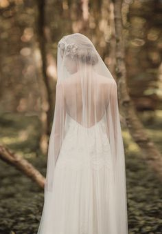 .I love the old style veils that just lay over you - no combs or pins or anything. they just softly fall around you. Even the shorter ones are pretty.