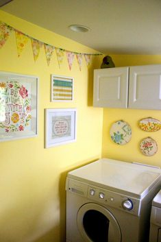 Whole laundry room decorated in vintage sheets. lovely! but it won't work with my red washer and dryer.... drat.