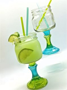 Set of Two Mason Jar Margarita Glasses. $22.00, via Etsy. Cute!  Just painted glass candle sticks?