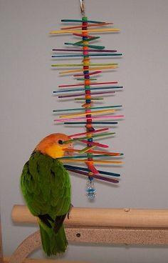 Petit oiseau bois jouet pile de bâtons Conure jouet