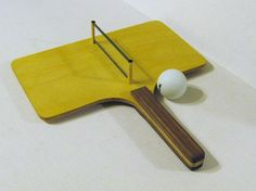 This is a hand held Ping Pong game that can be played by one person or more. I made the game of Walnut and Baltic Birch woods. It measures 10 wide by 11. Small enough to take with you. The net is removable for shipping or travel. Ball included. A great gift for all ages.