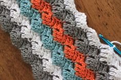 Free crochet blanket Pattern - doing this in rainbow scraps one day! love the stitch!