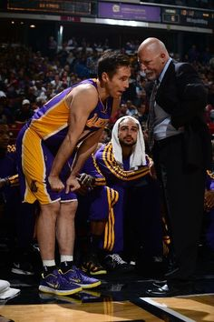 Steve Nash consults with the Lakers' trainer during a break in the action (March 30, 2013 | Los Angeles Lakers @ Sacramento Kings | Sleep Train Arena in Sacramento, California)