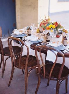 Up next, another lovely table from Carter & Cook Event Co. and Jill Thomas Photography. This one is a bit more classically autumn, but still with unexpected touches, like cupcake liner ruffles on the table runner, and chargers wrapped in yarn. Great inspiration for your fall wedding or your Thanksgiving table. Says Ashlyn Carter from …