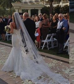 Fishtail wedding dress-like how the long veil still works with it