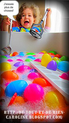Water table filled with floating Easter eggs and bubbles. Blog in French- has translator top right.