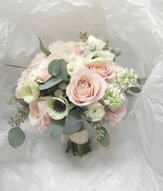 Blushing pink and white with a touch of silvery blue eucalyptus.
