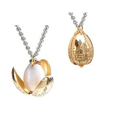 Harry Potter Golden Egg Pendant Chain - Miniature Golden Egg with petals that bloom open. Gold plated pendant comes complete with chain (50 cm) and wood display box.