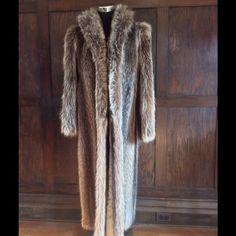Full length Tanuki raccoon fur coat This is a beautiful custom to Tanuki size small to medium. This beautiful coat is perfect in every way it's pelts are soft and supple with shiny black guard hair. This coat has been kept in the cold storage vault and has been professionally cleaned and glazed. A rare find for the price! Jackets & Coats