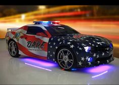 D.A.R.E Police Vehicle With Stars And Stripes Graphic Design.
