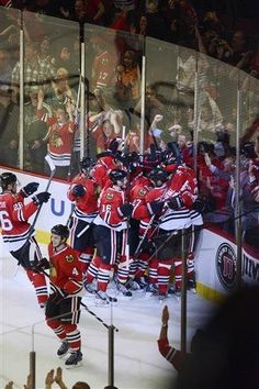 The Chicago Blackhawks celebrate the game-winner in overtime by Bryan Bickell Tuesday in Game 1 of an NHL hockey Stanley Cup playoff series Tuesday, April 30, 2013, in Chicago. The Blackhawks defeated the Wild 2-1. (AP Photo/Daily Herald, John Starks )