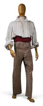 """A PAIR OF BLUE AND WHITE STRIPED PANTALOONS IN PATRIOTIC 'REVOLUTIONARY' COLOURS  FRENCH, LATE 18TH CENTURY  fall fronted, full length pantaloons, buttoned. See Historisches Museum, Berlin, for a suit of red, white and blue striped cotton of similar inspiration.  See also the red, white and blue striped jacket, Musée de la Mode et du Textile, Paris, achat 1955, illustrated in L'Homme Paré, Connaissance des Arts, page 25."""