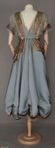 """WORTH BLUE SILK GOWN, PARIS, c. 1916, Blue twill, bodice of bronze lace over pink charmeuse under-dress, pink & blue tulle sleeves, swagged & fur trimmed hem, """"Worth"""" woven label petersham, couture # """"68506"""" stamped on reverse, B 34"""", W 28"""", L 48"""""""