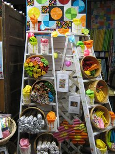 show display idea. another ladder idea for lots of creative ways to use it. Like the baskets to corral items on the ladder and add more items to the space