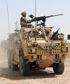 Personnel of 51 Squadron RAF Regiment patrol on a Jackal armoured vehicle around the perimeter of Camp Bastion