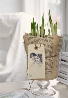 Wrap paper around a vase with twine and add a pretty photo tag for a uniquely styled planter.