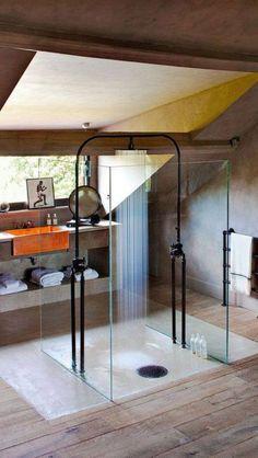 Attic glass encased rainhead shower! Very modern unique look!