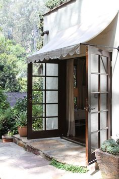 Jonah Jodies Enchanted Cottage in Laurel Canyon House Tour, white scalloped awning, dark wood french doors Patio Makeover, Door Makeover, Outdoor Spaces, Outdoor Living, Indoor Outdoor, Vibeke Design, Laurel Canyon, Marquise, Patio Doors