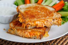 Buffalo Chicken Grilled Cheese dipped in ranch dressing.