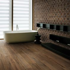 wood floor tiles with mosaic wood with marble surround look as a feature bathroom wall