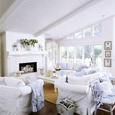 I love this cozy beach cottage living room! The white paneling gives the lofty space a crisp, cottage feel. I would add in some pops of color with some yellow and bright blue pillows for the white sofas. Cottage Living Rooms, Coastal Living Rooms, My Living Room, Living Room Decor, Cottage Lounge, Bedroom Decor, Shabby Chic Beach, Shabby Chic Cottage, Shabby Chic Homes
