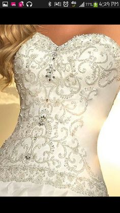 Love the sweetheart neck line and the embroidery