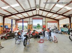 Garage fit for a king! This garage is huge! It obviously provides plenty of space to work on any cars, trucks, or other vehicles! Man cave to the extreme!  -- Luxury Homes --