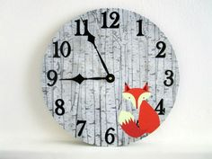 """A cute woodland themed fox wall clock that's just perfect for a rustic nursery. Great baby shower gift, too! This unique wall clock is hand made by us using an old 12"""" vinyl record, artwork and a batt"""