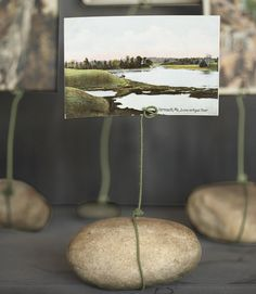 This would be so amazing if you had a collection of floral or outdoorsy pictures and you could make a cluster of holders.  My backyard doesn't have rocks that pretty though.  Next time I'm at the beach!
