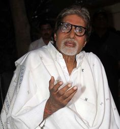 Indian Bollywood actor Amitabh Bachchan gestures during a press conference at his residence in Mumbai on April 25, 2012.