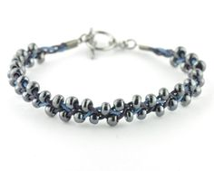 Seed beads are not just for bead weaving - check out this simple braided bracelet using size 5 seed beads, they're perfect for a design like this as their hole it large enough to thread onto 1mm cotton cord, not to mention they are great value at just £0.95 per 15g!