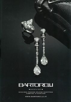 parure composta da anello e orecchini di diamanti su oro bianco by Bartorelli Maison