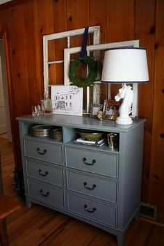Love everything about this. The dresser, the missing drawers, the old window panes, everything.