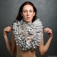 "Eliana R. Arenas  ""White/Black II""  Body Adornment, printed white vellum paper, wool, monofilament  40.64 x 22.86 x 20.32 cm"